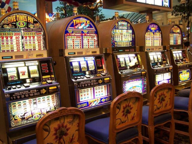 play slot machines at a casino